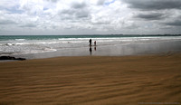Man and son walking Ninety Mile Beach