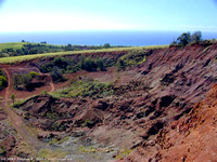 Red dirt, looking back toward Waimea town from Kokee Road