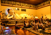 A reclining Buddha and worshipers