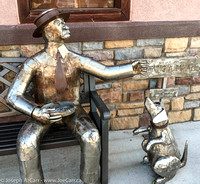 Street art: 'Sharing A Meal' a man and his dog, by David Voisard
