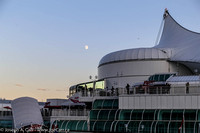 Moon rising over the prow of Canada Place