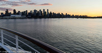 The Sun setting behind downtown Vancouver, Canada Place, the West End and Coal Harbour