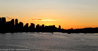 The Sun setting behind the West End and Coal Harbour