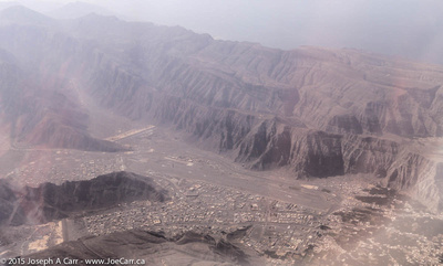 Aerial of residential development behind dams on two wadis south of Khasab