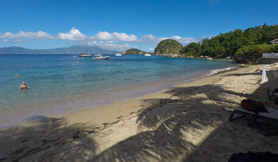 The beach and bay with boats moored