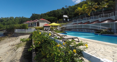 Hotel pool, patio and seaside bungalows