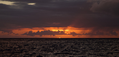 Sunset over the ocean showing the green flash