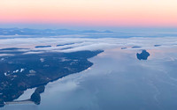 Looking north over layers of cloud to the Vancouver Island Range and Venus' Belt