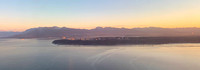 Looking north to Point Grey, English Bay and the North Shore mountains at sunrise
