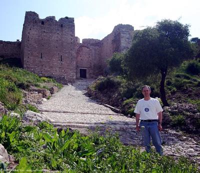 Joe climbing the cobblestone road to the third Acrocorinth gate