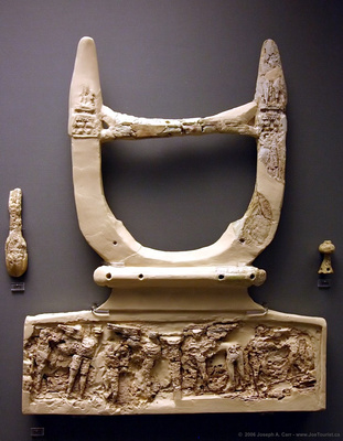 Ivory lyre with elaborate relief decorations