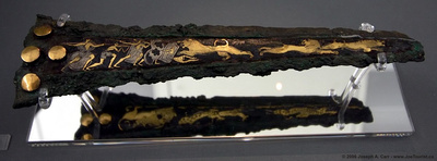 Bronze dagger with inlaid decoration depicting a lion hunt.