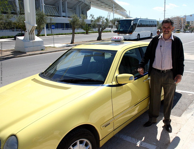 Paul and his Mercedes taxi in front of Olympic Stadium