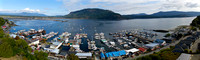 Aerial panorama of Cowichan Bay village, docks, the bay and Mount Tzouhalem