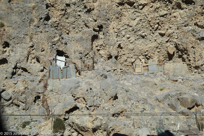 Old cliffside dwellings carved into the rock face'