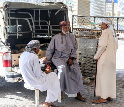Old men having lunch at the souq