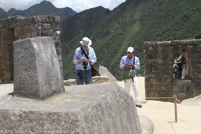 John McDonald and Grimaldo verify the North direction on the Incan sundial