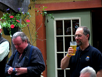 Dave Skea playing with a finger puppet. David Robertson enjoying his beer