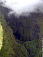 Flying over Keana'awi Falls & Wai'ale'ale Peak shrouded in cloud