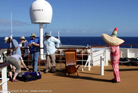 Observers setup on the top deck & woman with giant-sized sombrero