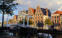 Draw bridge across main river through Haarlem with beautiful old buildings