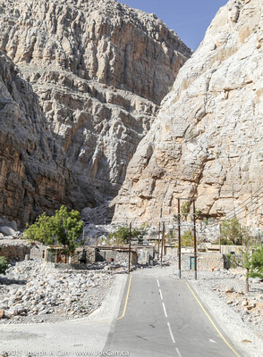 Steep rock faces and dwellings built in the wadi