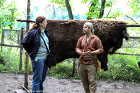 Pierre talking with one of the group in front of a buffalo pelt