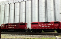 Canadian Pacific engines with grain elevators behind