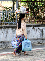 A woman carrying her shopping on her head