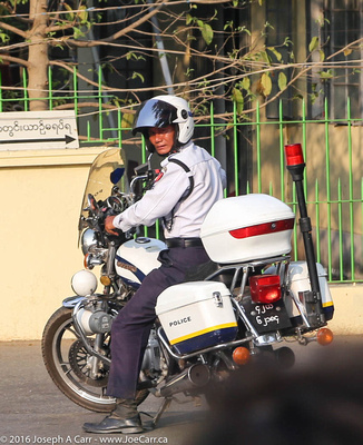 Our police escore in Yangon