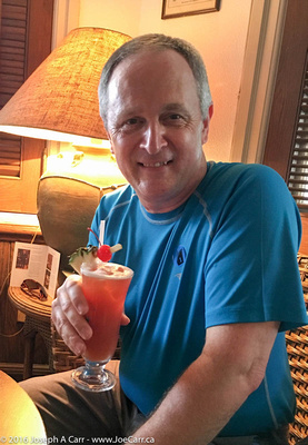 Joe with a Singapore Sling in the Long Bar at Raffles Hotel