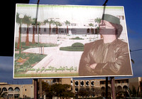 Giant Mu'ammar Gaddafi sign, Garyounis Resort behind