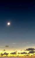 Fully eclipsed Sun with Venus and Mercury above