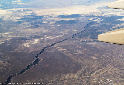 Canyon and flatlands - enroute San Francisco to Houston - flying over New Mexico