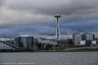 The Space Needle and the Science Center behind a waterfront park