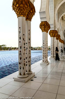Gold decorated columns and pool