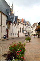 Hôtel-Dieu de Beaune on a cobblestone street