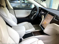 Cream coloured front seats, centre console, screen and driver controls and readouts