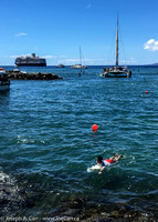Lahaina harbour traffic with a surfboarder and the  Eurodam anchored