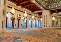 Iranian carpet, crystal chandeliers, decorative tile, and marble columns