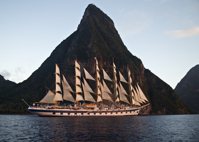 The Royal Clipper under sail as she departs Soufriere at sunset