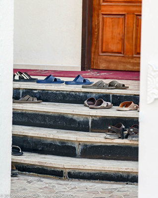 Shoes on the steps of the mosque