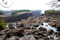 The dry Zambia side of the falls with the bridge & flowing Zimbabwe side visible behind