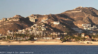 Condos on the hills behind Cabo San Lucas & the beach
