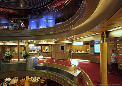 Volendam's Atrium: Promenade Deck 4 - Front Office & Shore Tours. Ocean Bar Deck 5 above