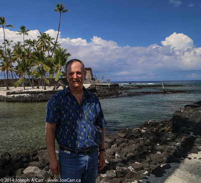 Joe in front of Keone'ele, the royal canoe landing and the Hale o Keawe