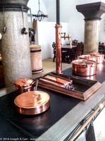 Copper pots on a stove in the castle kitchen