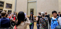 Crush of people in front of the Mona Lisa by Leonardo da Vinci