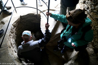 Steve and Mary descend the spiral staircase inside the castle wall