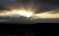 Crepuscular rays at sunset over Tauranga harbour